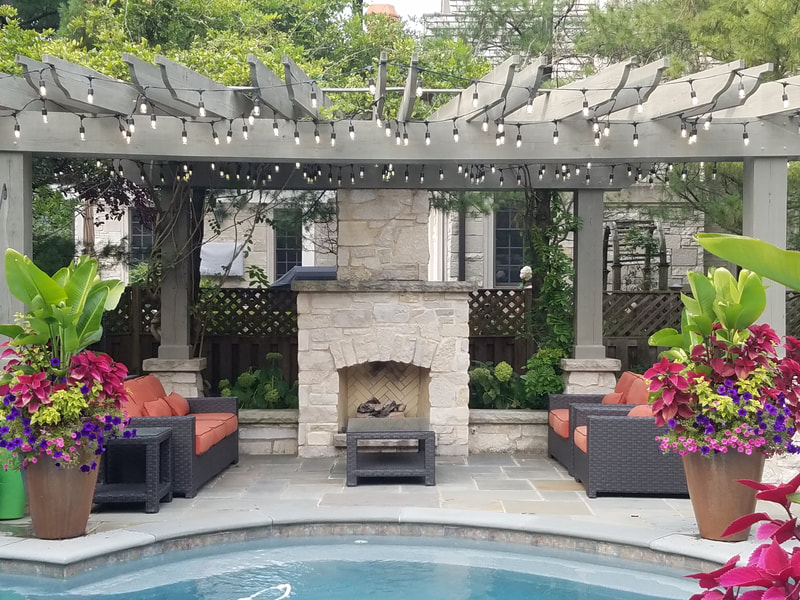 medium shot of backyard pool and covered lounge area with chimney