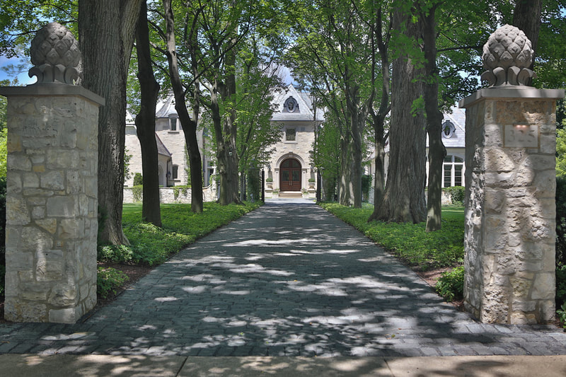 long driveway with trees on each side