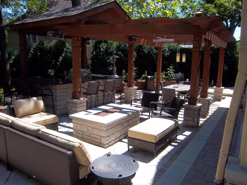 medium shot of patio furniture and fire pit