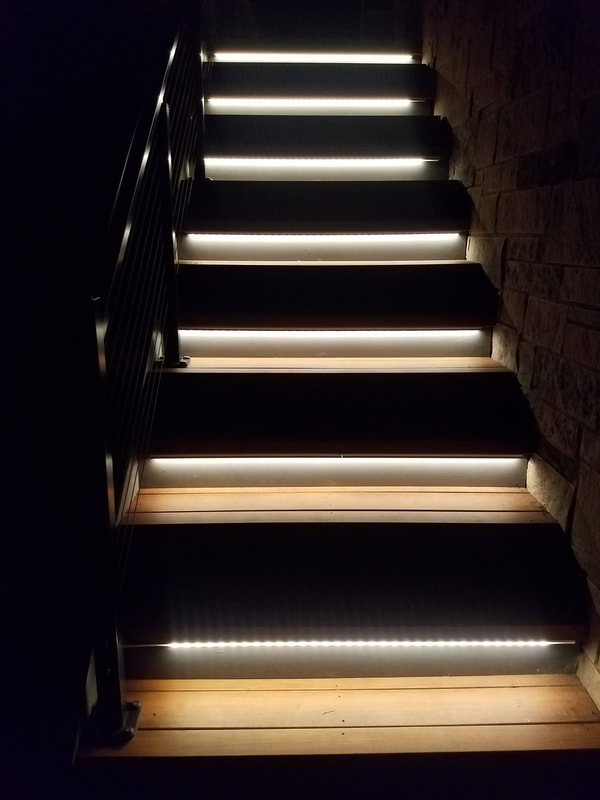 closeup of staircase with lighting