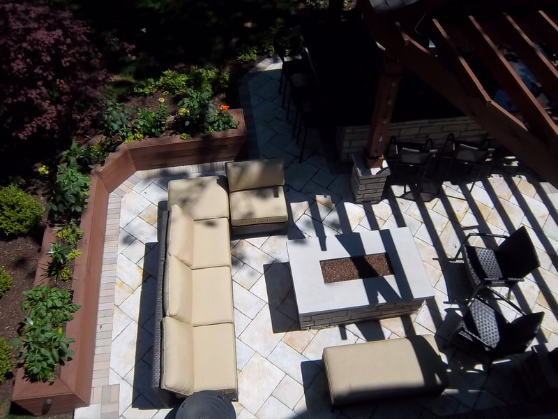 overhead view of back patio with furniture