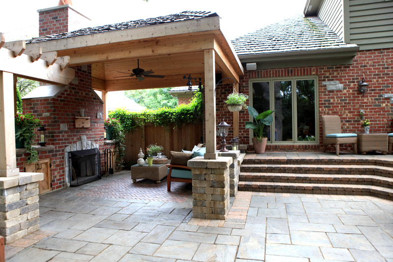 back patio with covered lounge area and fireplace