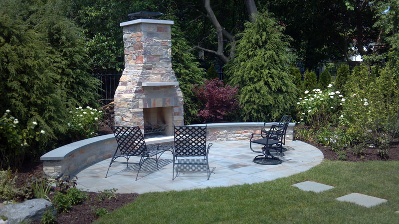 backyard fireplace and chimney with furniture